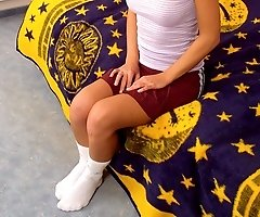 Blonde teen with purple panties under her skirt