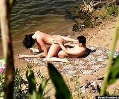 Excited pussycat rides her boyfriend near the water