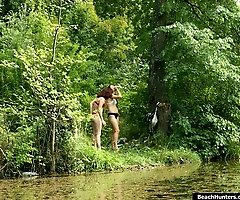 Two sexed up beach gals making lesbian love in woods