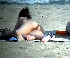Female nudists on a beach