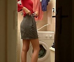 A blonde strips to do her laundry