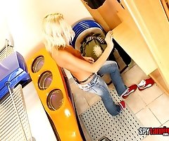 Blonde chick undresses in tanning salon booth!